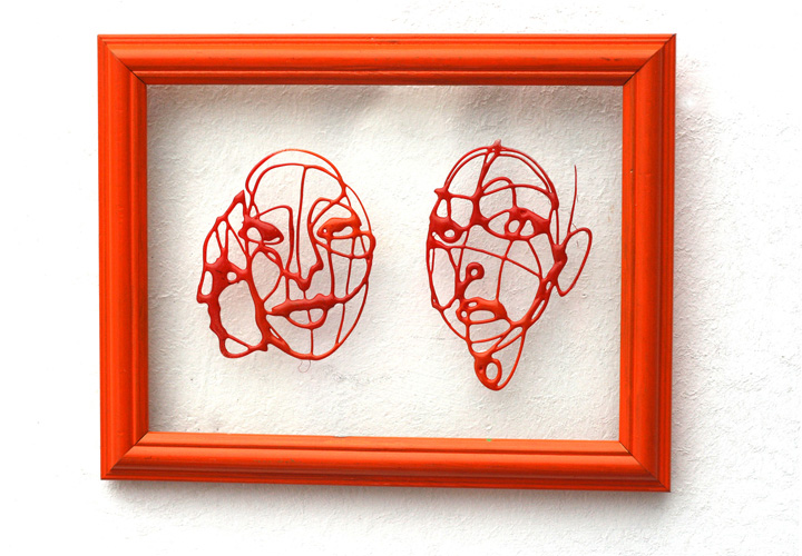 Small red faces 2011 Framed piece.jpg