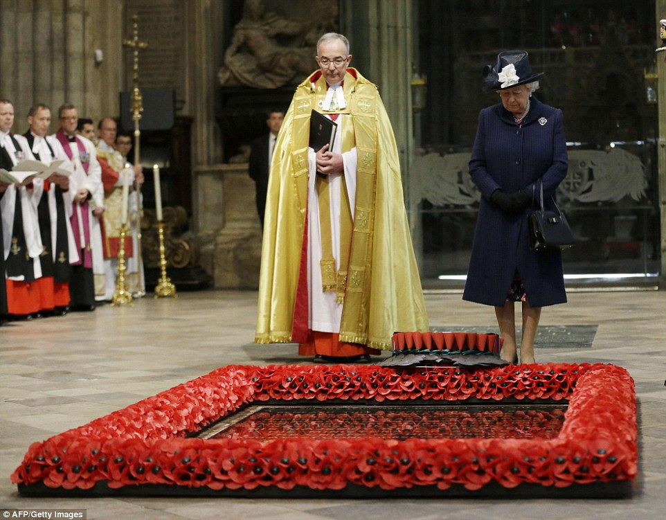 2885A69200000578-3075489-The_Queen_looks_down_after_a_wreath_was_laid_on_her_behalf_at_th-m-182_1431262959189.jpg