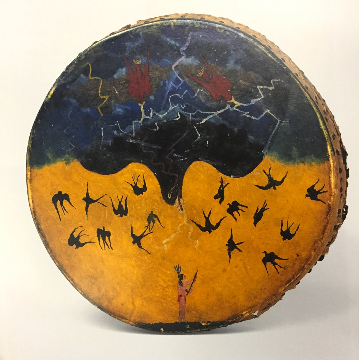 Double-sided drum (1890) by Chaticks-si-Chaticks (Pawnee) artist, Rawhide, wood, iron and pigment, Fenimore Art Museum, Cooperstown, New York. Taken from: Penney, David W. Native American Art Masterpieces. Hugh Lauter Levin Associates, 1997.