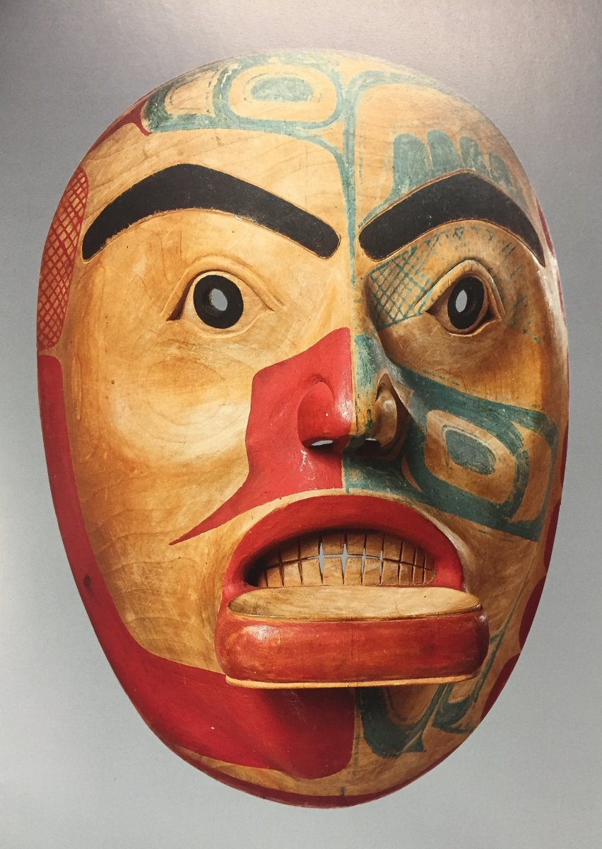 This mask came from a Alaskan Haida tribe who inhabits the Southern region of Prince of Wales Island. Hydabrug and Kasaan are the primary villages of the Haida people and the sea and forest are fundamental sources of sustenance of the people. The Haida culture is very rooted in their spiritual connection to the natural and physical world. The Haida society is divided into to moieties (ritual groups): the Raven and Eagle along with subclans beneath the two ritual groups. Similarly to southeastern tribes, Haida people manifest their spirituality through their craft of beautifully decorated button blankets, costume wear and props like the mask above. Their ethnic aesthetic stems from their animist belief as every traditional ornaments is wholeheartedly constructed with the blessings of the Haida society. The artistry behind their traditional items goes beyond just painting, colours and construction. Even being part of a clan within their matriarchal society can be channeled through the many narratives that are portrayed in Haida creativity. Additionally like most Native American tribes, the Haida culture do create and use masks and totem poles as part of their rituals. However unlike most clans, the legends, clans and art specialties of the Haida people are unique. Throughout history, Haida craftsmen have gained a reputation for masterful carving foremost for their dugout canoes. Moreover, more of Haida craft comes from artisans like silversmiths who are responsible for etching clan symbols onto jewellery and garments, which is a speciality obtained over a century ago when Haida craftsmen hammered American coins into jewellery.  *Source: http://www.litsite.org/index.cfm%3Fsection%3DDigital-Archives%26page%3DPeople-of-the-North%26cat%3DNative-Peoples%26viewpost%3D2%26ContentId%3D2650