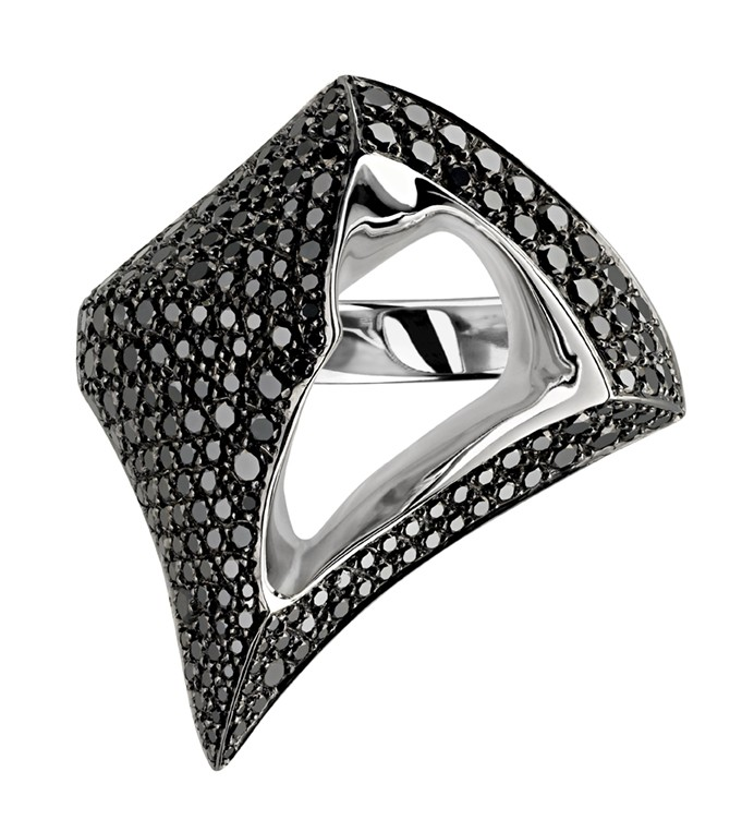 """from """"http://www.shaunleane.com/luna-ring-with-black-diamonds.html"""" The Luna collection translates the moon's majestic wonder and luminous natural contours into dazzling and sculptural high end diamond jewellery. Dramatically sweeping surfaces and detailed applications of diverse precious gemstones are definitive statements of the signature House of Shaun Leane style."""