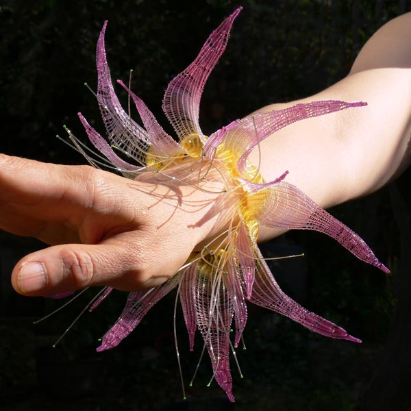 The way she have woven it shows the marve pink bell shaped petals standing.