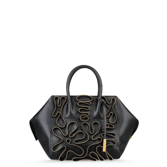 Medium sized alter nappa Boston bag in black featuring zip line embroidery detail.  A geometric and structured shape with a wide opening, zip fastening and dual handles.  Interior pocket and gold Stella McCartney logo engraved tag.
