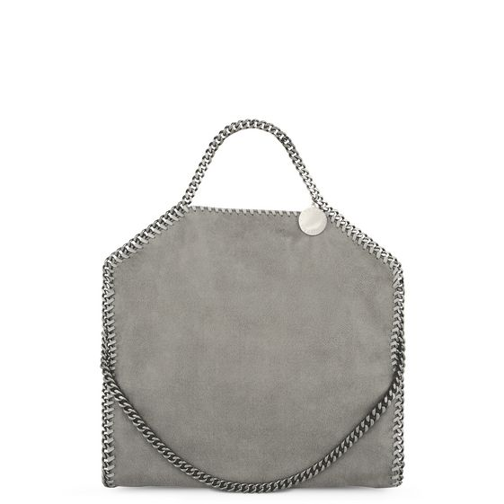 Fold over Falabella tote in light grey shaggy deer fabric with ruthenium chain hardware and Stella McCartney logo disc.  Fully lined with Stella McCartney logo print nylon, inside pocket and top snap closure.  This tote can be worn two ways, folded over as a shoulder bag or as a handheld tote.