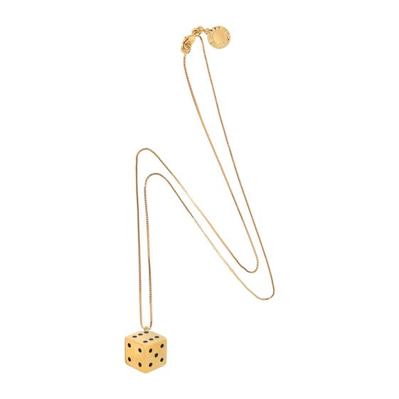 Brass necklace featuring a dice pendant. Fine chain and clasp closure with Stella McCartney logo disc.