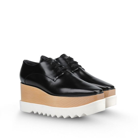 Alter nappa Oxford-style shoes in black featuring a sustainable wood platform wedge with a contrasting white chunky rubber saw-edge sole.  Lace fastening with a squared off toe.